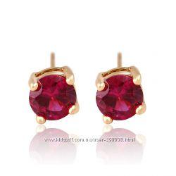 Серьги гвоздики с рубиновым камнем.