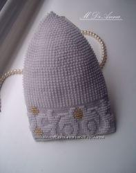 Вязаные с бисером комплекты и шапочки ручной работы