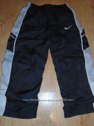 Теплые спортивные брюки Nike оригинал на 4-5 года.