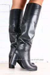 Женские кожаные сапоги-европейка на высоком устойчивом каблуке