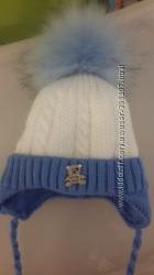 Эксклюзивная зимняя шапка на новорожденного
