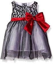 Продам нарядное платье Younglnd 4 года.