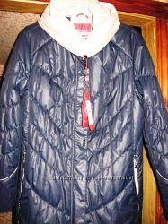 Удлиненная жеская куртка большого размера.
