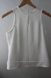 Оригинальная блуза топ  с пуговицами на спине