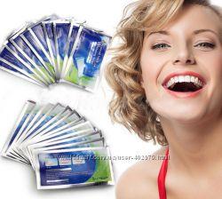 Отбеливающие полоски Advanced Teeth Whitening Strips.