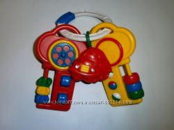Развивающая музыкальная игрушка-трещотка ключики, Fisher Price
