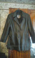 Продам кожаную куртку темно-зеленого цвета .