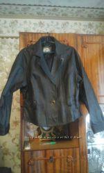 Продам кожаную куртку серого цвета .