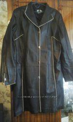 Продам кожаную куртку черного цвета .
