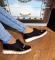 Туфли черные лаковые с бахромой на белой подошве