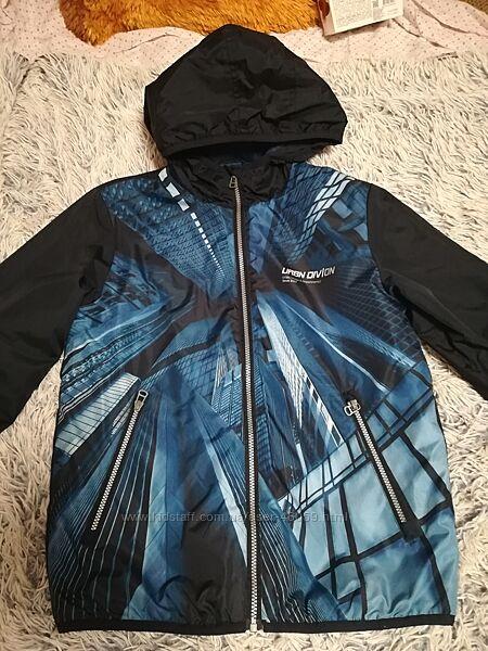 Продам демисезонную куртку для мальчика Ostin 16413/14