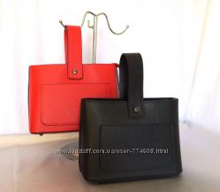 Стильная кожаная сумка с нестандартным дизайном