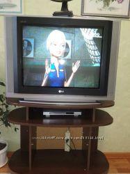 Телевизор LG с тумбой.
