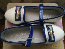 Белые туфли с бантиком