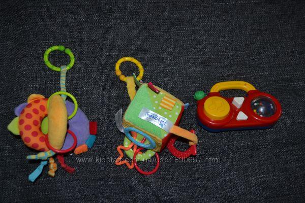 развивающие игрушки подвески новорожденному Fisher price