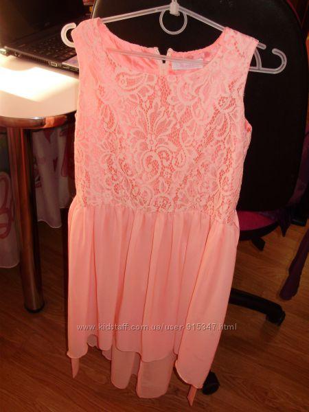 Платье на девочку персикового цвета