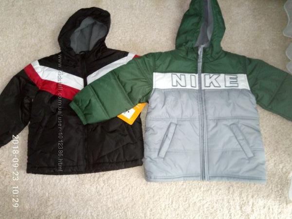 Куртки нові