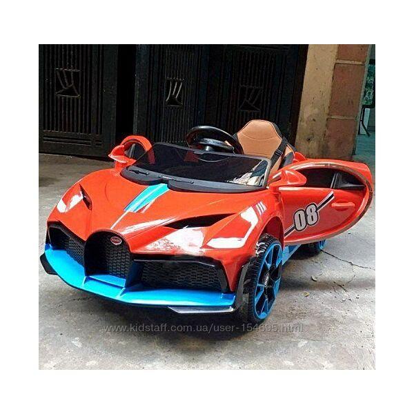 Детский мобиль Детский красный электромобиль  2 мотора по 18W, MP3, функция