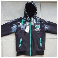 Двусторонняя демисезонная куртка для мальчика  122-140 р.