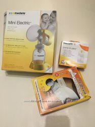 Молокосос medela mini electric пакеты для молока бандаж