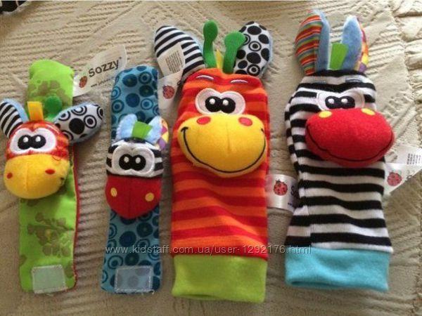 Игрушки погремушки браслеты и носочки набор 4 шт на ручки и ножки