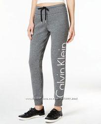 Фирменные трикотажные теплые спортивные брюки  серый меланж Calvin Klein
