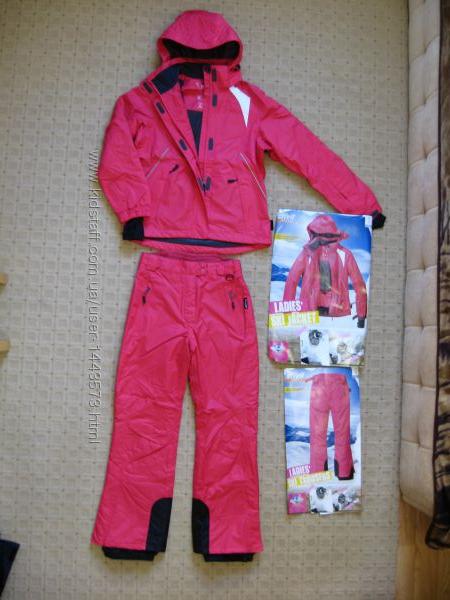Фирменные женскиq лыжныq костюм комбинезон
