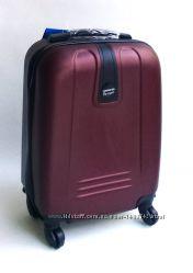 Качественные маленькие пластиковые четырехколесные чемоданы. Много цветов