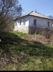 Продам земельный участок с домиком